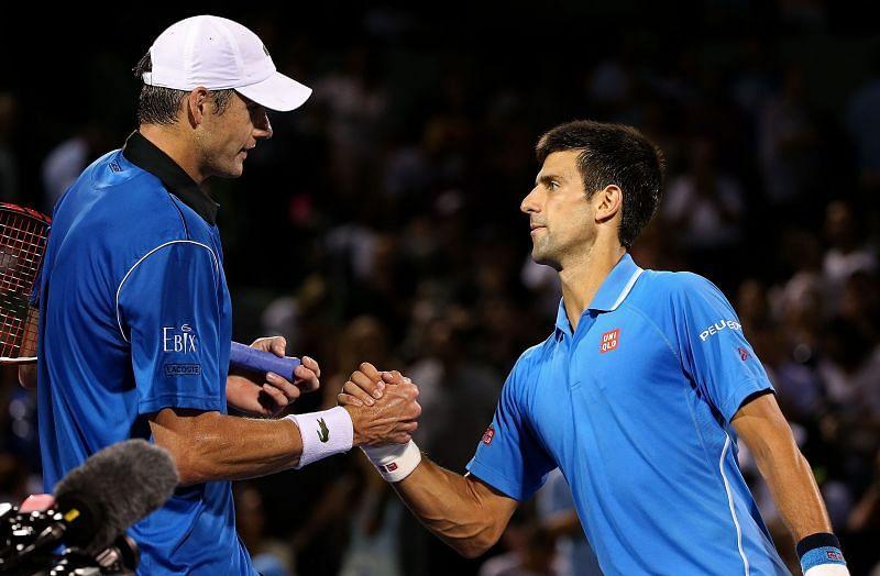 John Isner (L) and Novak Djokovic