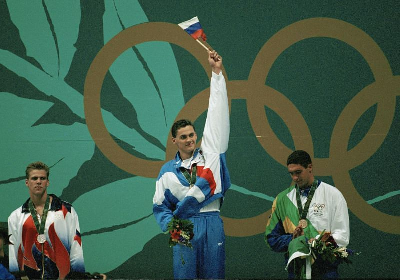 Alexander Popov of Russia (C) celebrates winning the gold medal in the Men