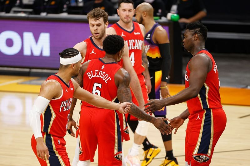 Zion Williamson, Josh Hart, and Eric Bledsoe of the New Orleans Pelicans celebrate after scoring against the Phoenix Suns (Photo by Christian Petersen/Getty Images)