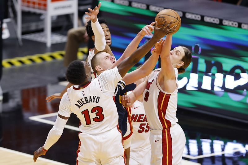 Bam Adebayo and Kelly Olynyk of the Miami Heat defend a shot by Nikola Jokic of the Denver Nuggets during the third quarter at American Airlines Arena on January 27, 2021. (Photo by Michael Reaves/Getty Images)