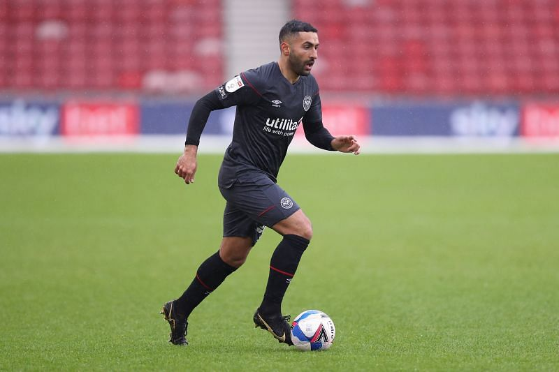 Saman Ghoddos will be in action for Brentford against Reading