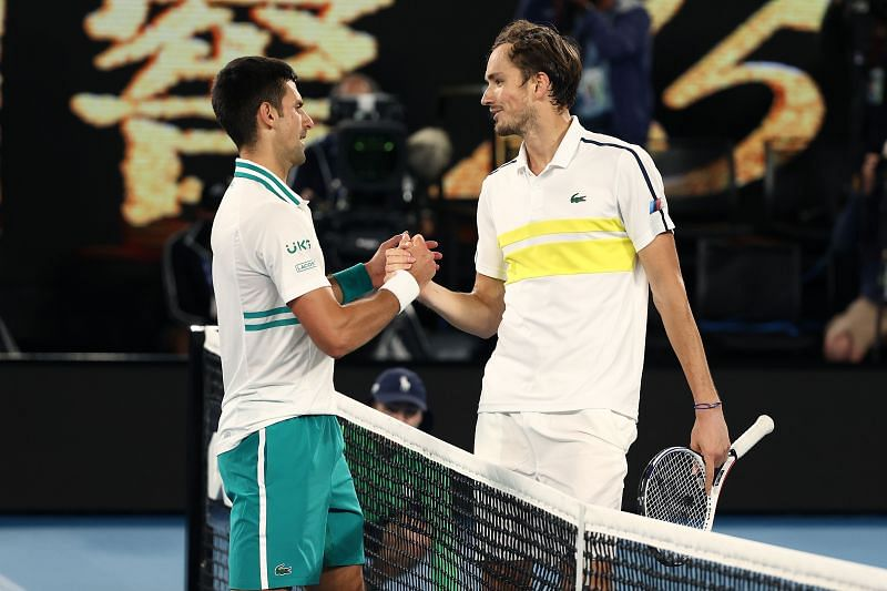 Daniil Medvedev congratulates Novak Djokovic after the final