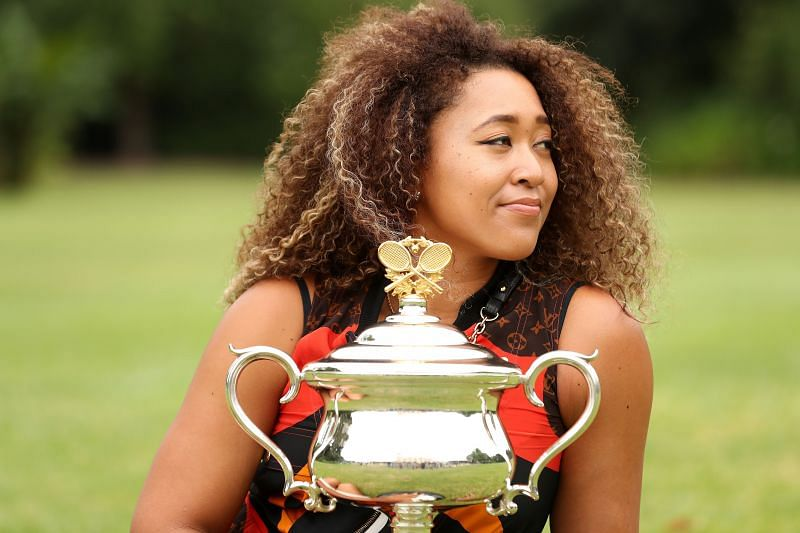 Naomi Osaka poses with the 2021 Australian Open trophy