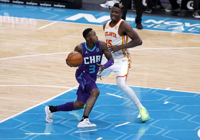 Terry Rozier #3 of the Charlotte Hornets drives to the basket against Clint Capela #15 of the Atlanta Hawks.