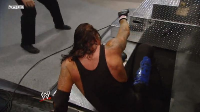 The Undertaker moments after his fall through the door