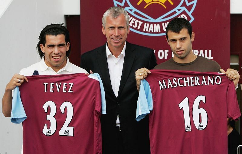 Tevez and Mascherano pose with West Ham manager Alan Pardew after their shock move to the Hammers