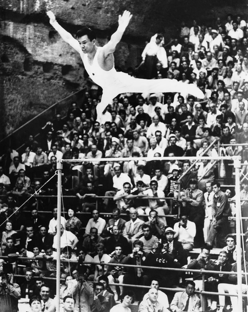 Japanese gymnnast Takashi Ono competing on the uneven bars in the men