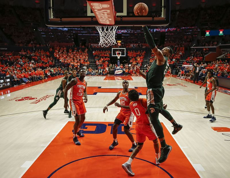 The Michigan State Spartans shoot the ball over Alan Griffin #0 of the Illinois Fighting Illini