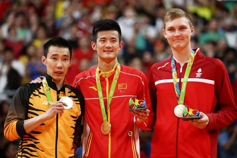 Silver medalist Chong Wei Lee of Malaysia, gold medalist Long Chen of China and bronze medalist Viktor Axelson of Denmark pose on the podium during the medal ceremony for the Men