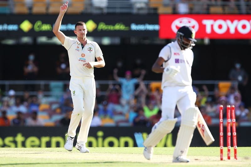 Siraj walks back to the pavilion after being bowled by Hazlewood