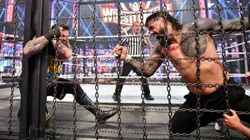 Jey Uso eliminates Kevin Owens from the Elimination Chamber on Sunday night.