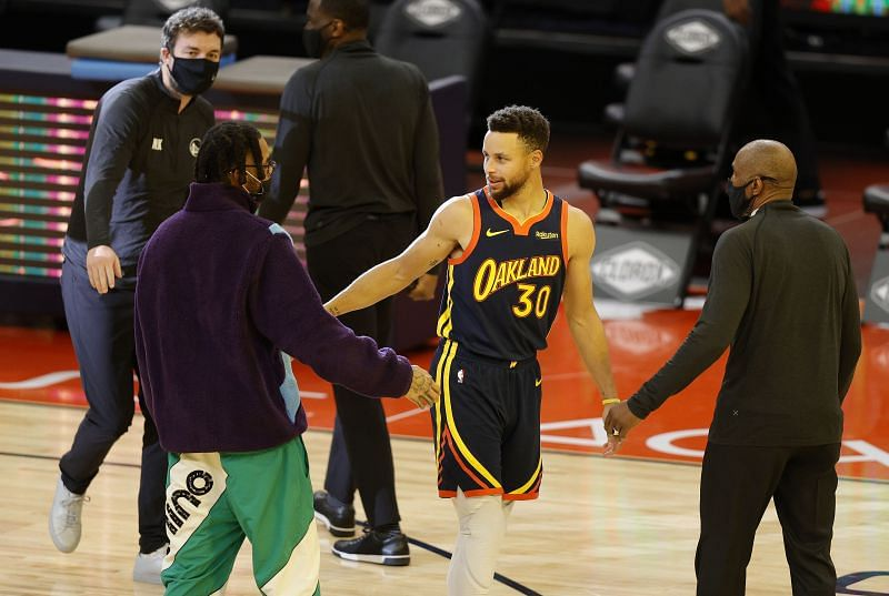 Stephen Curry #30 of the Golden State Warriors greets former teammate D