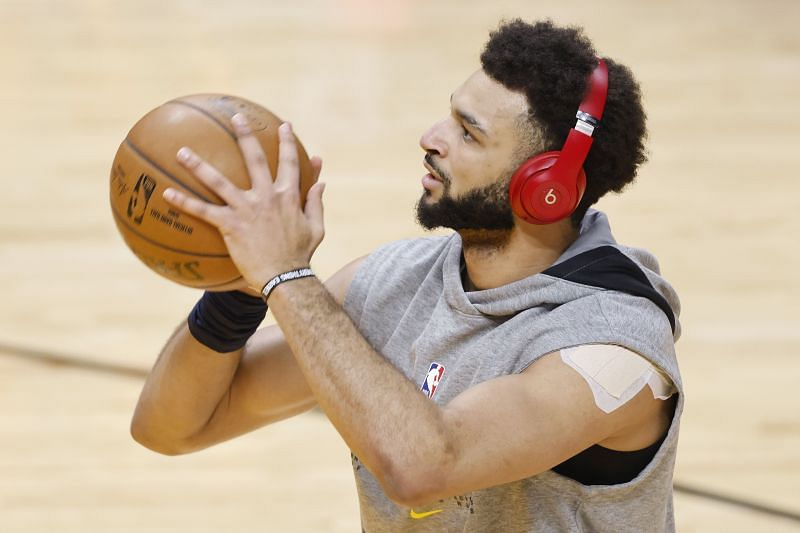 Jamal Murray #27 of the Denver Nuggets warms up prior to the game against the Miami Heat at American Airlines Arena on January 27, 2021 in Miami, Florida. (Photo by Michael Reaves/Getty Images)