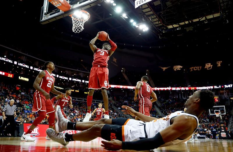 The Oklahoma Sooners grabs a rebound against the Oklahoma State Cowboys.