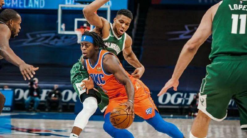 Antetokounmpo tries to prevent Dort from drivin [Image: NBA.com]
