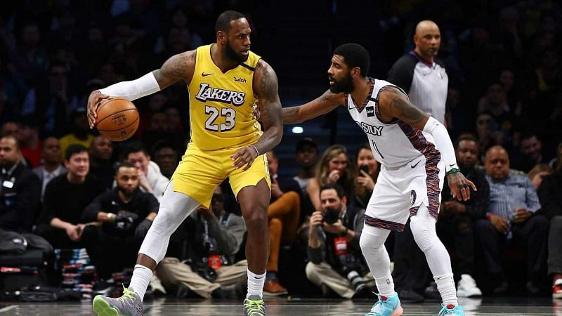 Kyrie Irving guards LeBron James as the Brooklyn Nets host the LA Lakers