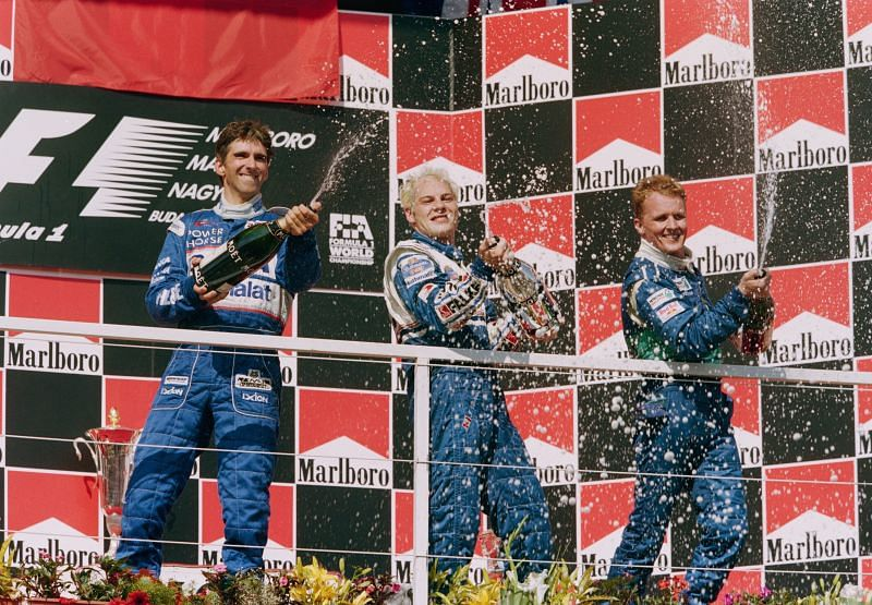 Jacques Villeneuve (C) of Canada sprays champagne after winning the Hungarian Grand Prix August 1997 with second-placed Damon Hill (L) and third-placed Johnny Herbert: Getty Images