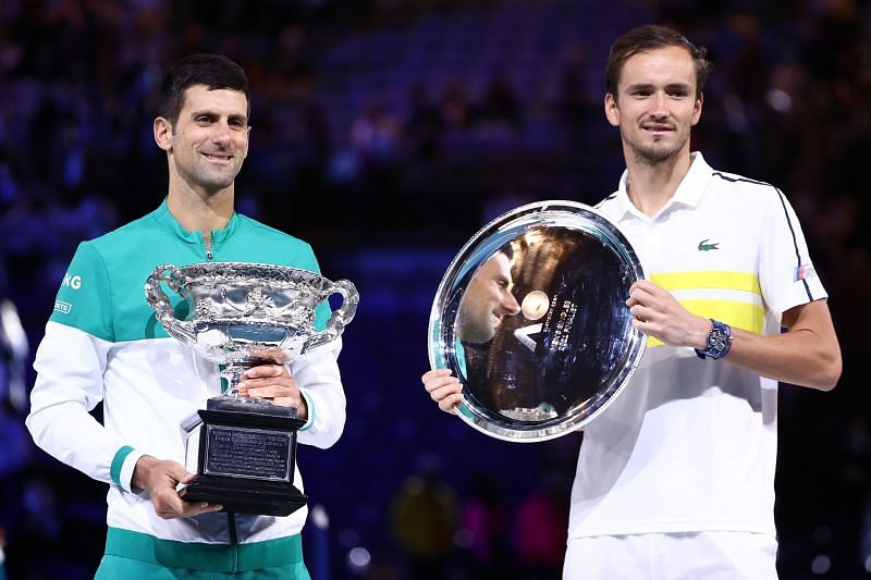 Novak Djokovic and Daniil Medvedev with their trophies