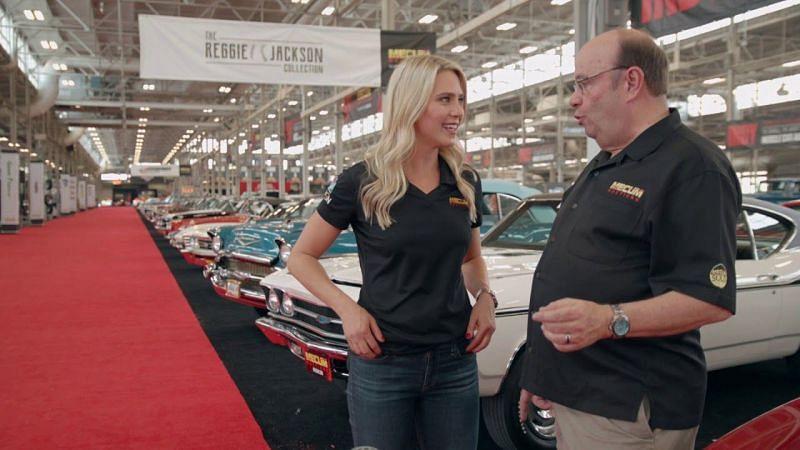 Katie Osbourne with Mecum Auction car expert John Kraman. Photo: Mecum Auctions