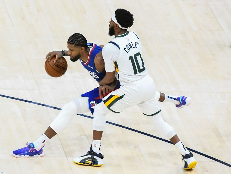 Paul George of the LA Clippers goes up against Mike Conley of the Utah Jazz