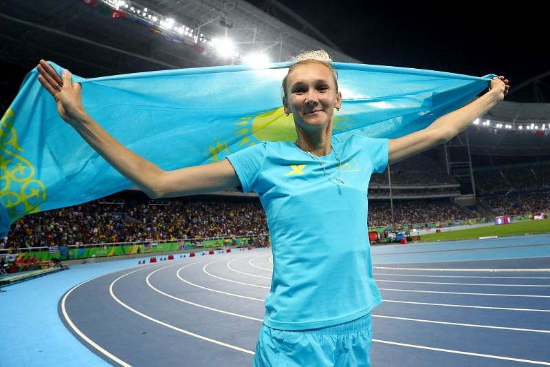 Olga Rypakova celebrates winning bronze in the Women