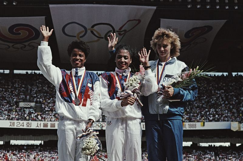 Florence Griffith-Joyner celebrates winning the gold medal in the Women