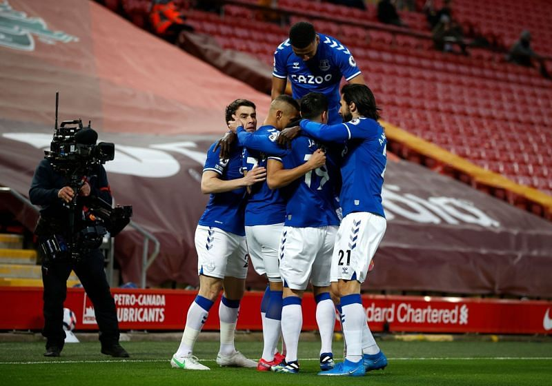 Everton celebrate their opening goal against Liverpool at Anfield.
