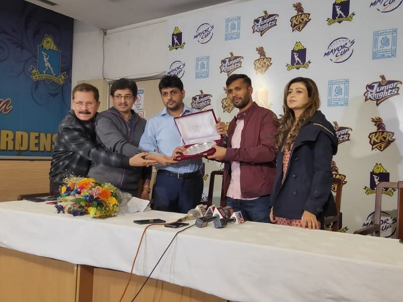 Ashoke Dinda was presented with a silver plaque and bouquet for his contributions to Bengal cricket [Credits: Srinjoy Sanyal]
