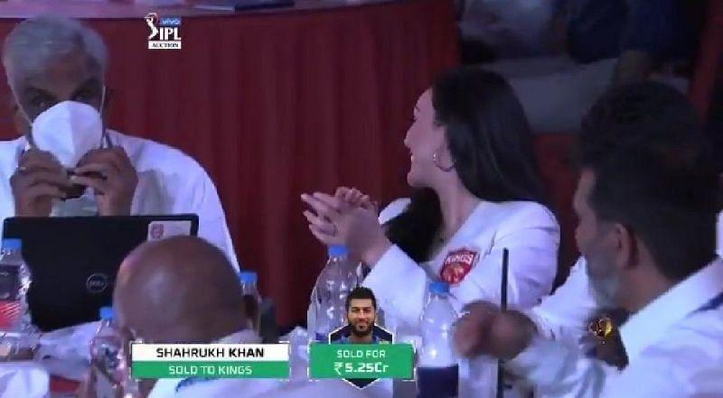 Preity Zinta reacts after snapping up Shahrukh Khan.