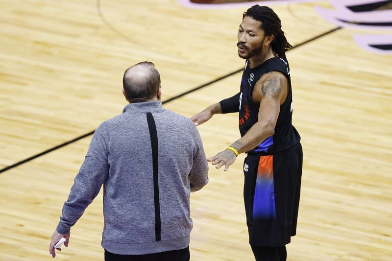 Head coach Tom Thibodeau of the New York Knicks talks with Derrick Rose #4 in a game against the Miami Heat