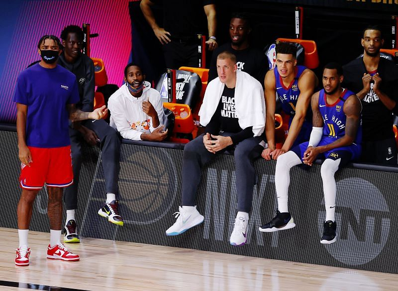 The Denver Nuggets bench watches the action during the fourth quarter against the Utah Jazz.