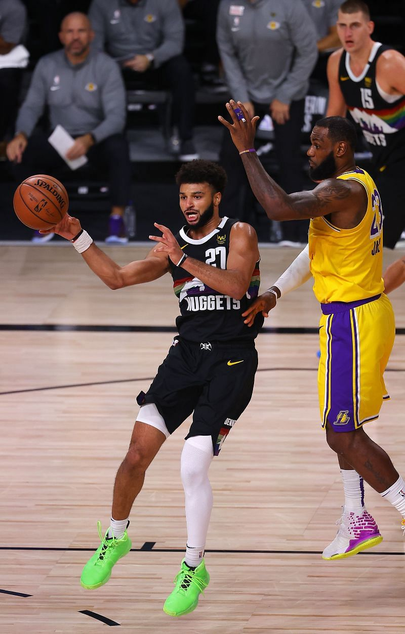 Jamal Murray of the Denver Nuggets goes up against LeBron James of the LA Lakers