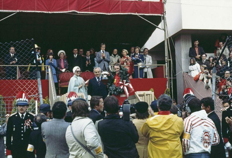 Prince Rainier III of Monaco (C) and Princess Grace (L) presenting the Monaco Grand Prix trophy to Niki Lauda in 1975