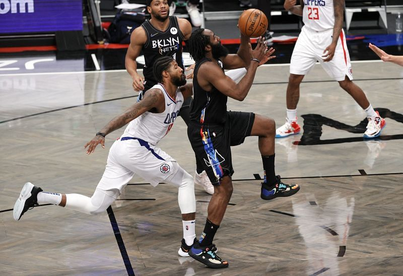 James Harden #13 of the Brooklyn Nets shoots as Paul George #13 of the LA Clippers defends.