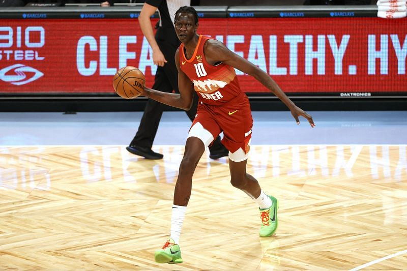 Bol Bol of the Denver Nuggets passes the ball during the first half against the Brooklyn Nets at Barclays Center on January 12, 2021, in the Brooklyn borough of New York City. (Photo by Sarah Stier/Getty Images)