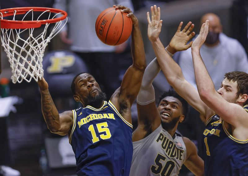Chaundee Brown #15 of the Michigan Wolverines grabs the rebound