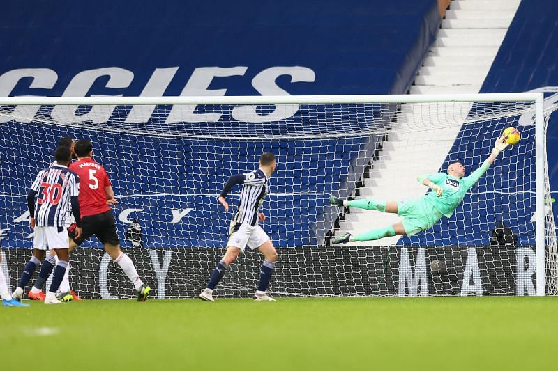 Sam Johnstone had to dive full stretch to deny a late Manchester United goal.
