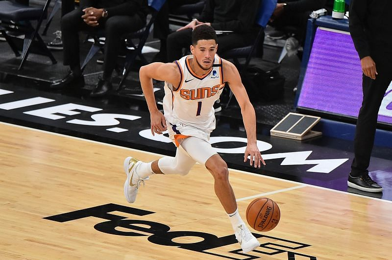 Devin Booker #1 of the Phoenix Suns brings the ball up court