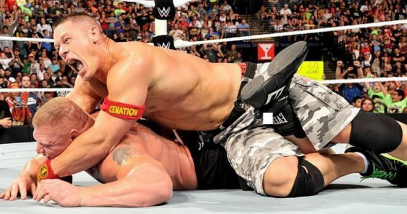 Brock Lesnar trying to fight out of John Cena