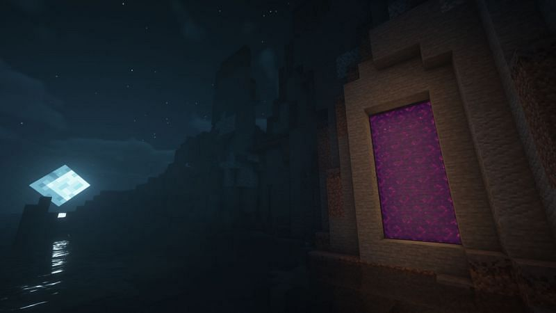 A large Nether Portal embedded in a mountain (Image via Minecraft)