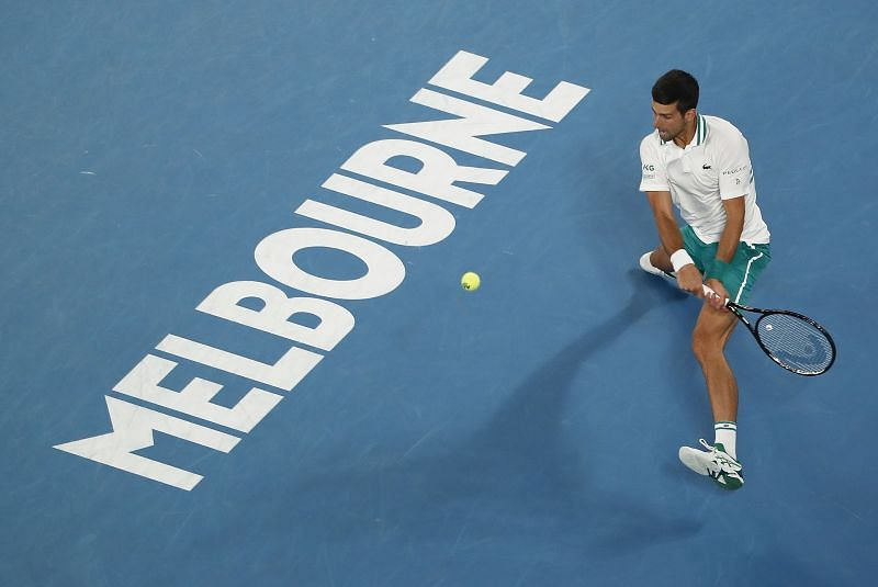Novak Djokovic hits a backhand