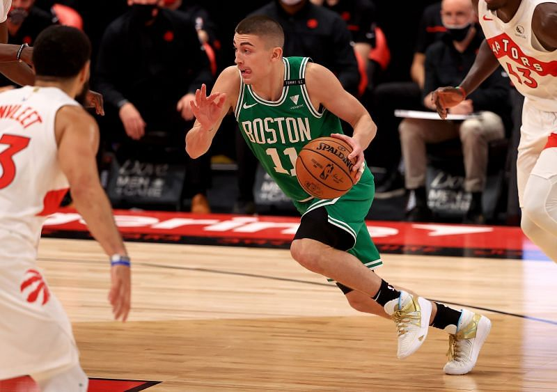 Payton Pritchard #11 of the Boston Celtics drives during a game against the Toronto Raptors