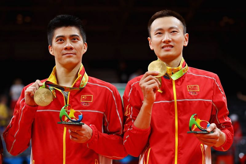 Gold medalists Haifeng Fu and Nan Zhang stand on the podium during the medal ceremony after the Men