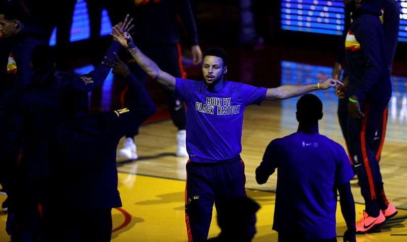 Stephen Curry of the Golden State Warriors is introduced before a game against the Boston Celtics.