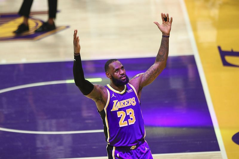 LeBron James #23 of the LA Lakers celebrates his basket at the end of the third quarter against the Memphis Grizzlies at Staples Center on February 12, 2021