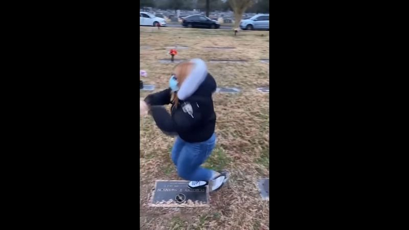 Adult female dancing on top of a tombstone (Image Via YouTube/Pegasus)