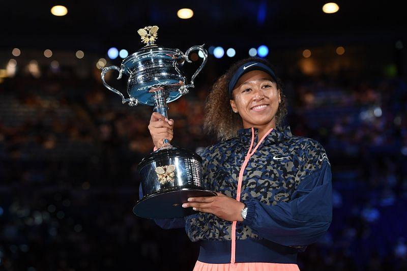 Naomi Osaka poses with the 2021 Australian Open trophy
