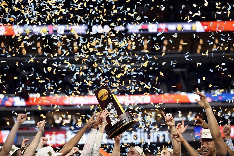 The Virginia Cavaliers celebrate with the NCAA March Madness trophy after their teams win in the 2019 NCAA men