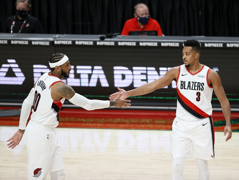 Carmelo Anthony #00 and CJ McCollum #3 of the Portland Trail Blazers high five during the first half against the Utah Jazz at Moda Center on December 23, 2020, in Portland, Oregon. (Photo by Steph Chambers/Getty Images) (Photo by Steph Chambers/Getty Images)