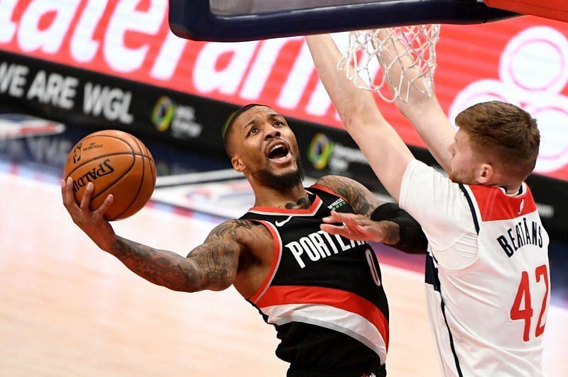 Damian Lillard of the Portland Trail Blazers drives to the basket against Davis Bertans of the Washington Wizards.